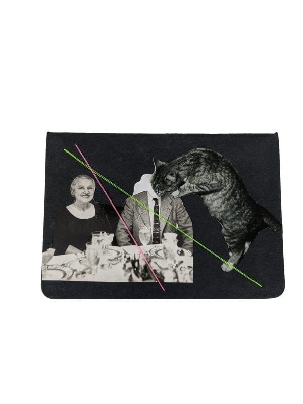 Embroidery art on small black notebook, collage of cat drinking from neck of man sitting to dinner with wife
