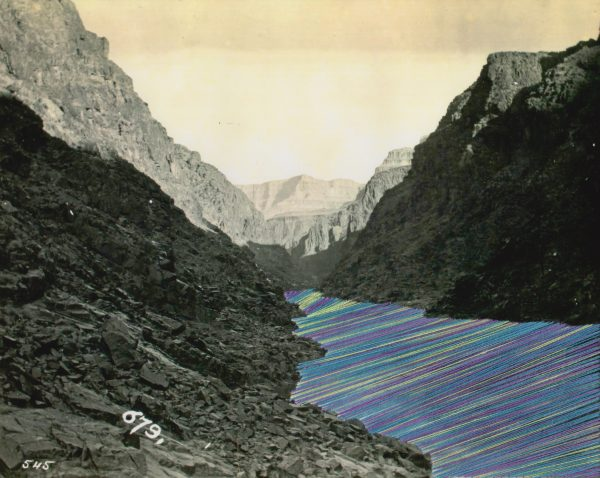 Embroidery Art, neon green purple and blue threaded river between mountains black and white photo