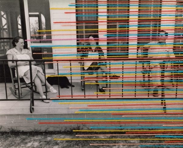 Embroidery art, multicolored thread lines on black and white photo