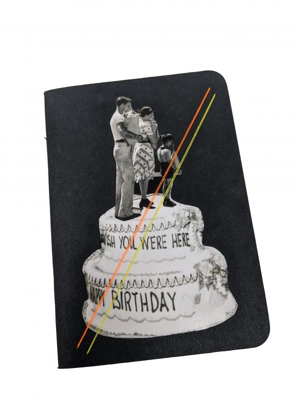Pocket size black notebook with collage of family walking on top of cake